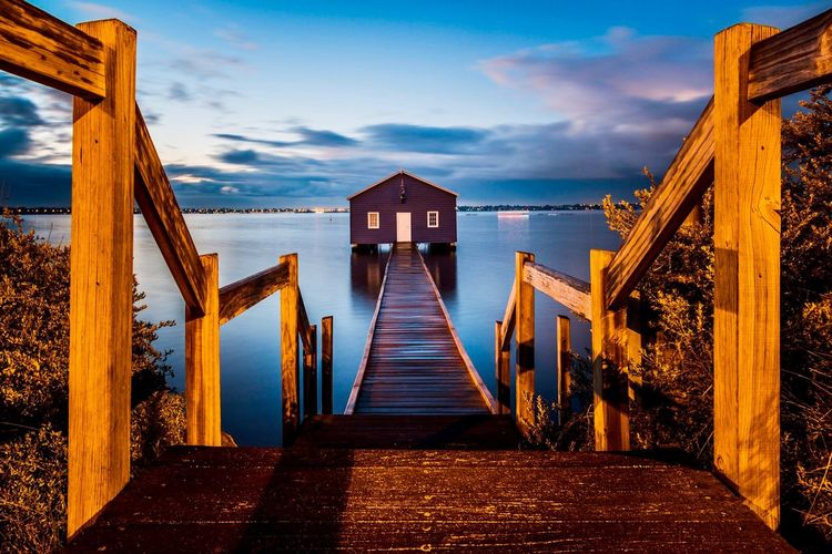 View of the famous Crawley Edge Boatshed (also known as the Blue Boat House) in Perth at the break of dawn. Crawley Edge Boatshed Blue Boat House Australia Perth Australia Perth Architecture Built Structure Cloud - Sky The Way Forward Sky Direction Nature Railing Beach Tranquil Scene Diminishing Perspective Staircase