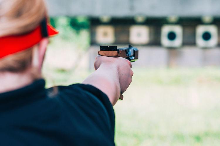 Close-up of woman aiming gun