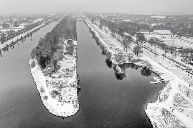 High angle view of snow covered bridge in city