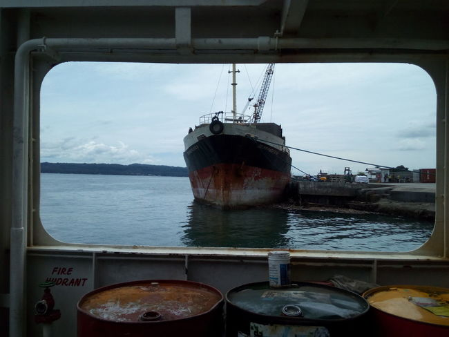 Perspective shot of a shipping vesself from the barge. Water Sea Sky City No People Day Outdoors Nature Close-up Barge Ships Shipping Docks Shipping Containers Shipping Yard Travel Travel Destination Travelphotography Travelgram Destination