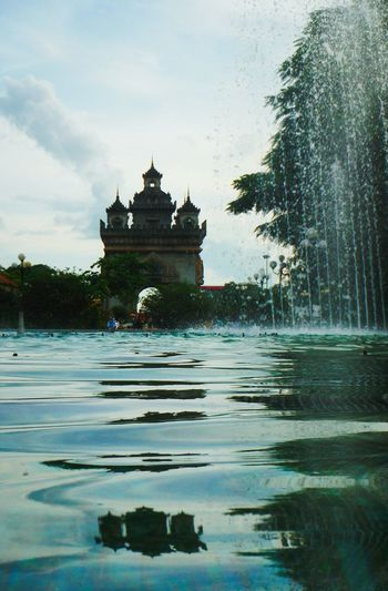 Patuxai Laos Explore Laos Vientiane Laos Vientiane, Laos Vientiane Arc De Triomphe Laos Patuxai Laos Water Fountain Waterfountain Water Fountain Water Reflection Water Surface Water Ripples Monument Travel Laos Travel Asia Travel Destinations Architecture French Influence Laos Monument Laos Travel Laos Collection Reflection