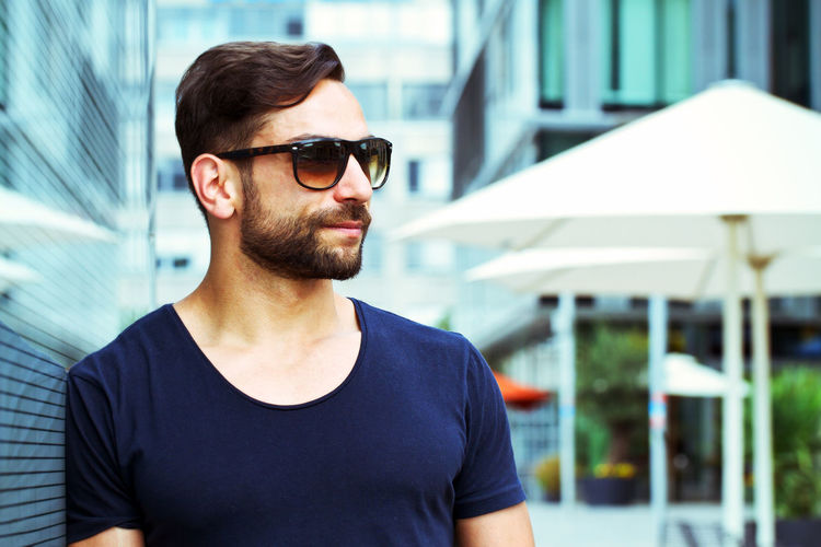 Young, modern man with sunglasses Baden-Württemberg  City Cool Fashion Glasses Man Modern Stuttgart View Beard Face Germany Handsome Leisure Leisure Activity Lifestyles Men Optician Outdoors Portrait Style Summer Sunglasses Town Young Men