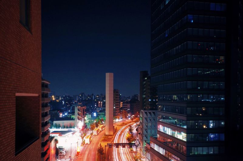 Japan Shinjuku Tokyo Architecture Building Exterior Built Structure City City Life Cityscape Clear Sky Illuminated Light Trail Long Exposure Modern Motion Night No People Outdoors Road Sky Skyscraper Speed