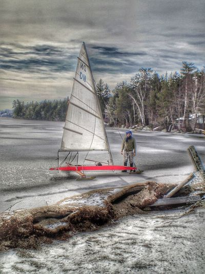 Outdoors Day Winter Cold Temperature Real People Sea Men Nautical Vessel One Person Cloud - Sky Sky Leisure Activity Nature Beach Fine Art Photography People Ice Snow Ice Boat Scenics Fashion Lake Beauty In Nature Tranquility Landscape Snow Sports