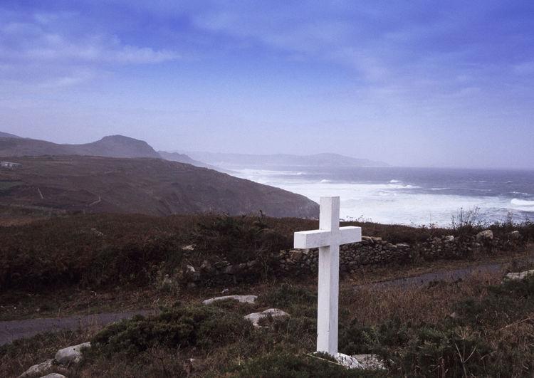 Cross On Field Against Sea