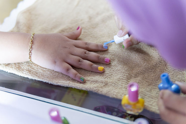 it's painting fingernails day!!! Human Hand Hand Human Body Part Women Indoors  Selective Focus Body Part People Adult Nail Nail Polish Close-up Real People Lifestyles Holding Human Finger Finger Females Applying Manicure Painting Fingernails Human Limb Toenail A New Beginning