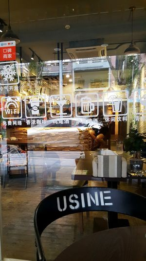 Alley Cafe scene in Dongguan Cafe Reflections Retail  Store Window Designs light and reflection Embrace Urban Life