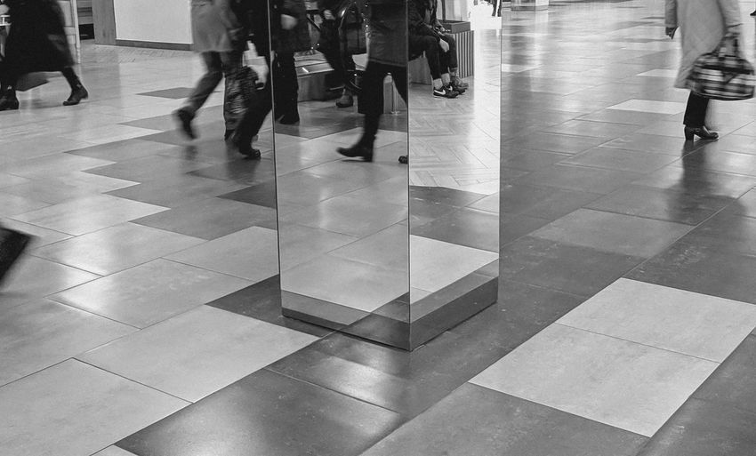 Mobile Photography Black And White Monochrome Legs Shoes Reflections Mirrorless Mirror Reflection Feets Walking Floor Flooring Perspective Pattern Low Section Men Commuter Rush Hour Businessman Subway Train Women City Waiting Train - Vehicle Tiled Floor Tile Tiled Wall