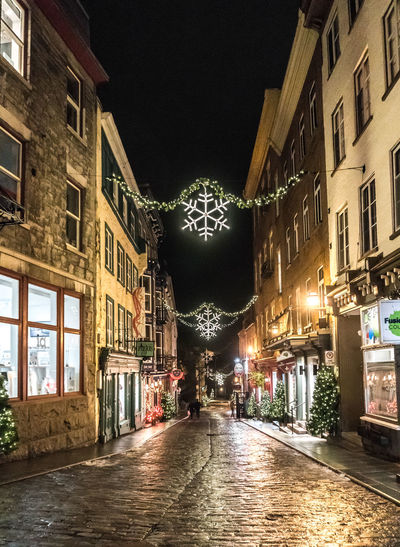 Christmas Cobblestone Streets Lights Old Quebec City Shopping Tourist Attraction  Winter Architecture Building Exterior City Decorations Destination Evening History Illuminated Night No People Outdoors Retail  Season  Sky Snowflake Tourism Way Forward Window Holiday Moments