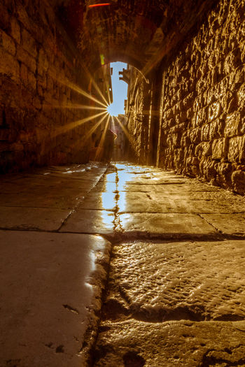 Architecture Built Structure Tunnel The Way Forward Illuminated Direction Indoors  Transportation One Person Nature Real People Sunlight Wall Day Building City Wet Wall - Building Feature Light At The End Of The Tunnel Surface Level