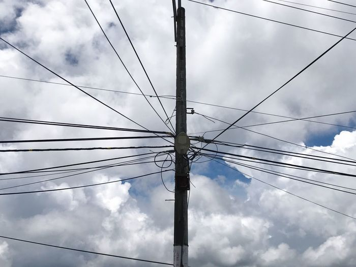 Cable Connection Power Line  Power Supply Electricity  Cloud - Sky Low Angle View Sky Fuel And Power Generation Technology Day Complexity Outdoors Electricity Pylon No People Telephone Line Spider Web