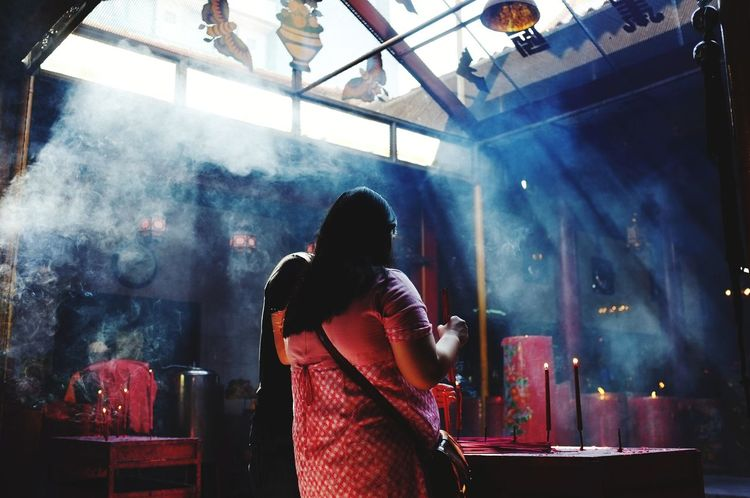 Praying Praying Budha Temple Budha Vihara Religion Street_photography Streetphotography Urban Streetphoto Fujifilm Only Women Adult Smoke - Physical Structure One Person Rear View People Indoors  Arts Culture And Entertainment Lifestyles EyeEmNewHere