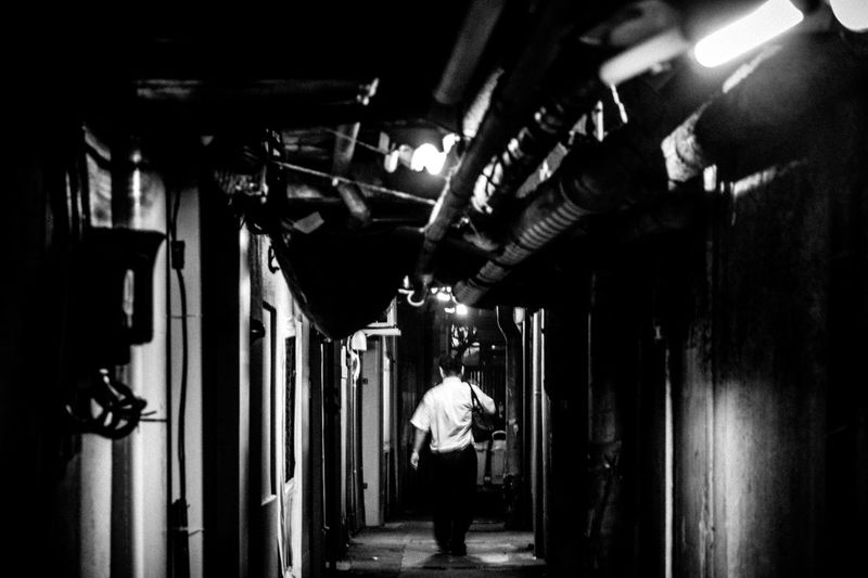 Alone Walk This Way Telling Stories Differently Untold Stories Notes From The Underground Atmospheric Mood Backalley Black And White Capture The Moment Darkness And Light Man Darkness Fine Art Fine Art Photography From My Point Of View Monochrome Photography People And Places Japan Monochrome Embrace Urban Life Night Pivotal Ideas Chance Encounters Street Photography Urban Exploration