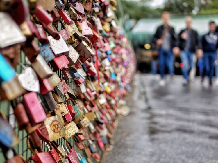 Love padlocks at a bridge Padlock Love Lock Lock Love Security Abundance Hope - Concept Safety Hanging Selective Focus Metal Bridge - Man Made Structure Incidental People Outdoors Variation Day Large Group Of Objects Protection Hope Railing
