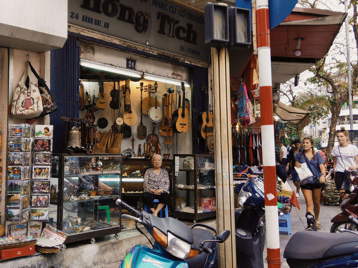 Old Lady Scooter Tourists Guitar Market People Sale Shopping Store Street Photography Women EyeEmNewHere