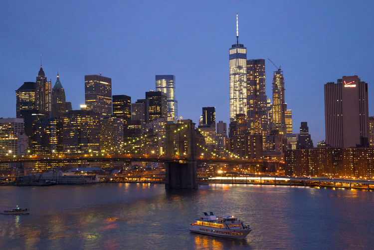 Architecture Bridge - Man Made Structure Building Exterior Built Structure Business Business Finance And Industry City Cityscape Downtown District Futuristic Harbor Illuminated Manhattan Modern Nautical Vessel New York Night No People Outdoors Sky Skyscraper Tower Travel Destinations Urban Skyline Water