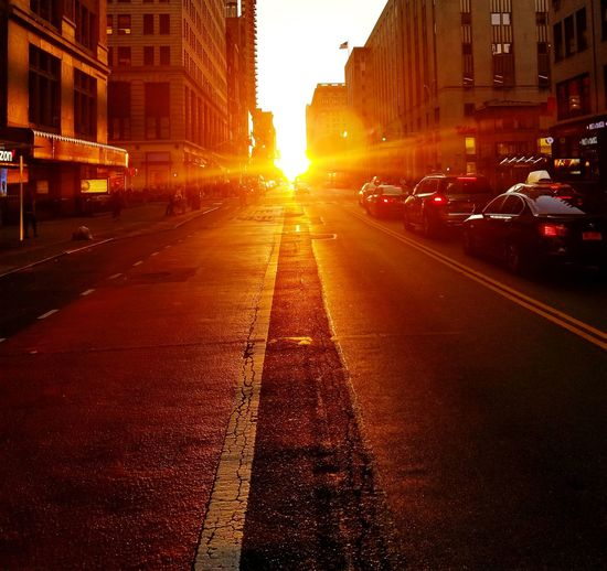Sunburst Across 23rd Street Photography Sunset Across 23rd Sunset Silhouettes New York City Manhattan Sunset Rays Of Sunshine Sunset Rays Orange Sunset Orange Sunset Rays Manhattanhenge Sunset Roadway Yellow Taxi Skyscraper