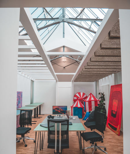 Business Office Absence Architecture Built Structure Ceiling Chair Day Decoration Empty Flooring Furniture Indoors  Lighting Equipment Luxury Modern No People Office Supply Red Seat Startup Table Wall Wood Wood - Material