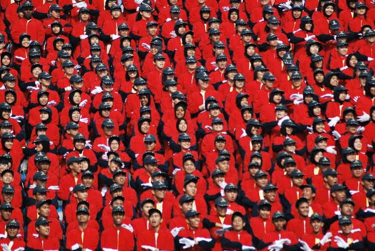 Full frame shot of people standing in red uniform during celebration