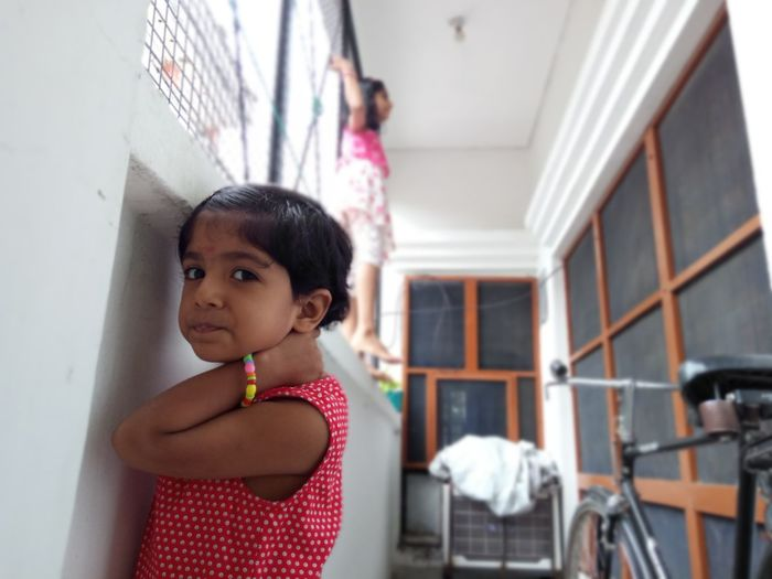 Portrait of cute girl standing at home