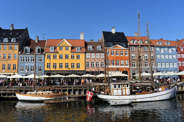 Nyhavn Colourful Denmark Architecture Building Building Exterior Built Structure Canal City Copenhagen Day Group Of People Mode Of Transportation Nature Nautical Vessel Nyhavn Outdoors Passenger Craft Row House Sky Terraced Transportation Travel Travel Destinations Water Waterfront The Architect - 2018 EyeEm Awards