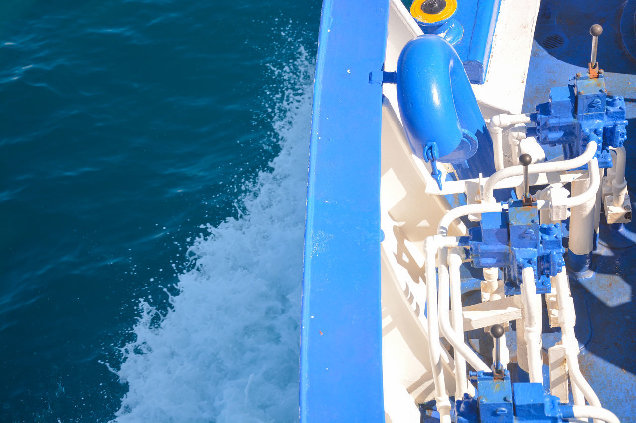 water, blue, sea, nature, day, nautical vessel, no people, transportation, outdoors, high angle view, mode of transportation, sunlight, motion, sport, holiday, railing, sailing, metal, ship