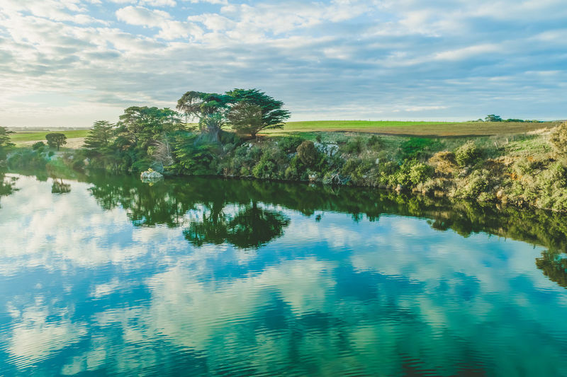 Trees reflecting in the river at sunset Allansford Cloudscape High Up Hopkins River Horizon Landscape Sky Sunrise Travel Locations Aerial Australia Background Beautiful Drone  Grass Lookout Outdoor Reflections River Scenic Shores Sunset Travel Travel Destinations Trees Victoria View Warrnambool Water
