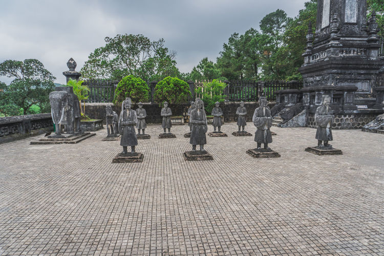 Statues at temple against sky