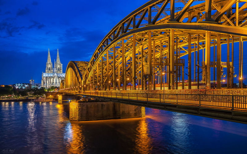 [Klassiker] Architecture Blue Bridge Bridge - Man Made Structure Built Structure Capital Cities  City City Life Cloud - Sky Cologne Cologne Cathedral Connection Engineering Illuminated K Martin Führt No People Outdoors Rhine River Sky Tourism Travel Destinations Water