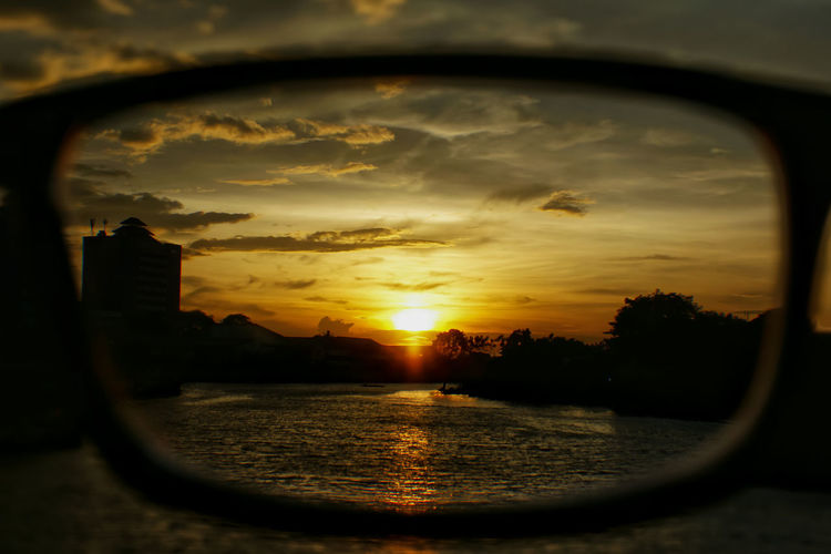 Sunset in my eyes Landscape_Collection Petualangcemen Landscape_photography Cisadane River Tangerang Sunset_collection Sunset Silhouettes Water Tree Sunset Reflection Dramatic Sky Sky Close-up Landscape Cloud - Sky Refraction Moody Sky Silhouette Horizon Over Water Romantic Sky Shore Scenics Tranquil Scene