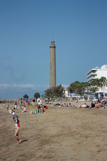 Faro de Maspalomas Architecture Beach Built Structure Day Holiday Large Group Of People Lighthouse Men Nature Outdoors People Real People Sand Sky Tourism Vacations in PLAYA DEL INGLES - GRAN CANARIA -