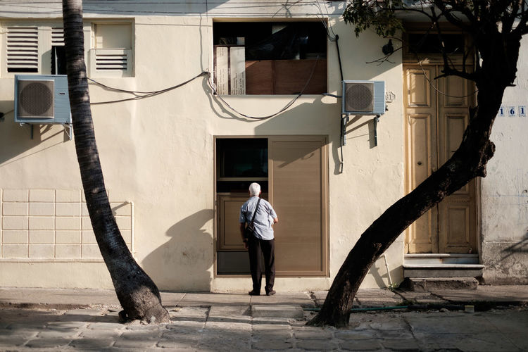 Man Standing Against House