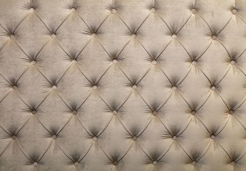 Beige capitone textile background with buttons Bed Beige Chesterfield Upholstery Backgrounds Brown Buttons Capitone Chesterfield Sofa Close-up Design Diamond Pattern Fabric Full Frame Interior Material No People Old-fashioned Pattern Softness Textile Textured  Tufted Wallpaper White