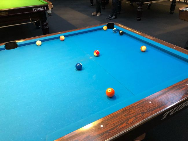 Snooker Pool Ball Ball Pool Table Pool - Cue Sport Table Sport Pool Cue Leisure Games Leisure Activity Indoors  Blue Bar - Drink Establishment Multi Colored Relaxation No People Playing Pool Hall Sphere Motion Snooker