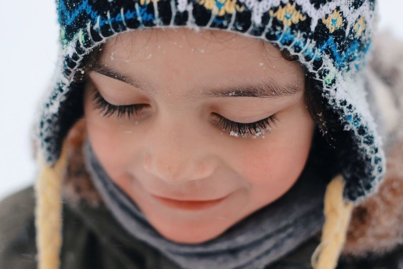 Close-up portrait of girl in snow
