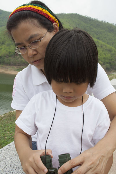 Kaeng Krachan Dam Mother And Son Love Cute Binoculars Vacations Thai Children Asianboy Asianwoman Two People Wireless Technology Portable Information Device Looking Down Technology Child Teenager Togetherness Water Boys People Day Childhood