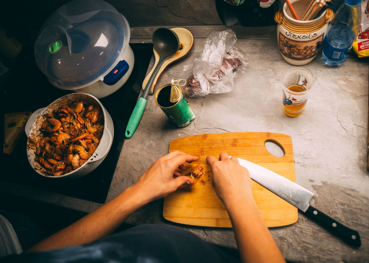 High angle view of woman preparing food on table