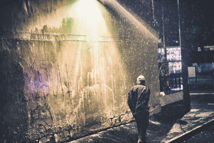 Urban Streetphotography Street Rain Rainy Days Night Illuminated One Person Water Men Adult Street Light Glowing