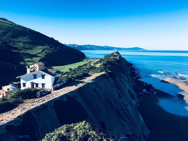 Sea Building Exterior Blue Architecture House Built Structure Outdoors Nature Scenics Day Mountain Beauty In Nature Clear Sky Tranquil Scene Tranquility No People Horizon Over Water Water Sky Beach Rosafrancomendoza Architecture Zumaia