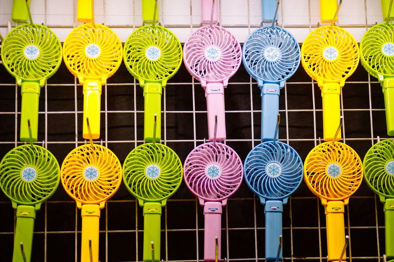Full frame shot of colorful fans on metal grate