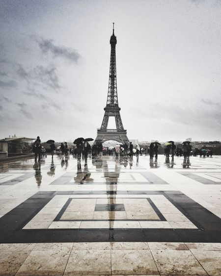 Melancholic mood for an autumn in Paris Toureiffel Paris Paris, France  Eiffel Tower Reflections Travel Destinations Travel Photography Architecture_collection Architecturelovers Landscape_Collection Landscape_photography France PhonePhotography Melancholic Landscapes Rainy Days City Water Symmetry Silhouette History Cultures Sky Architecture Travel Built Structure Monument Black Swan Autumn Mood