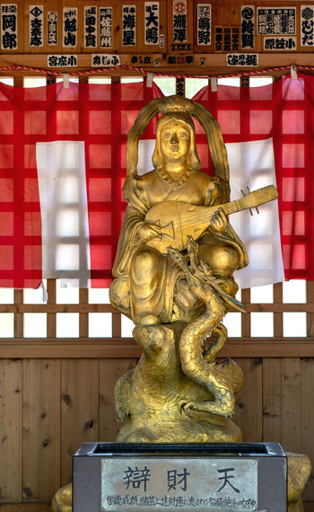 Sculpture Art And Craft Representation Statue Human Representation No People Architecture Text Male Likeness Gold Colored Built Structure Day Travel Destinations Western Script Craft Spirituality Outdoors City Close-up