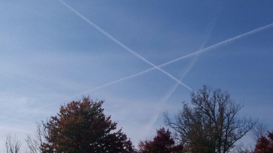 Vapor trail flight path, sky