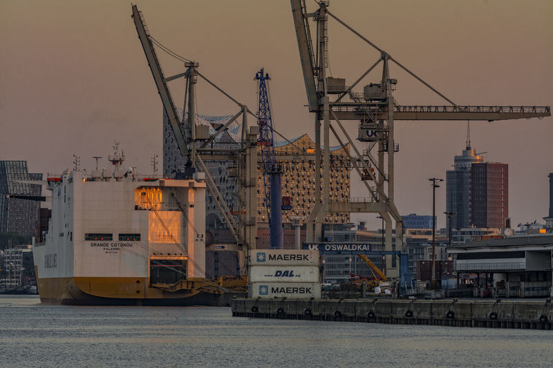 InTheHansahafen Architecture Commercial Dock Construction Construction Site Container Containership Crane Crane - Construction Machinery Day Elbe River Harbor Industry Mast Morning Light Morning Sun No People Outdoors Ship Sky Water