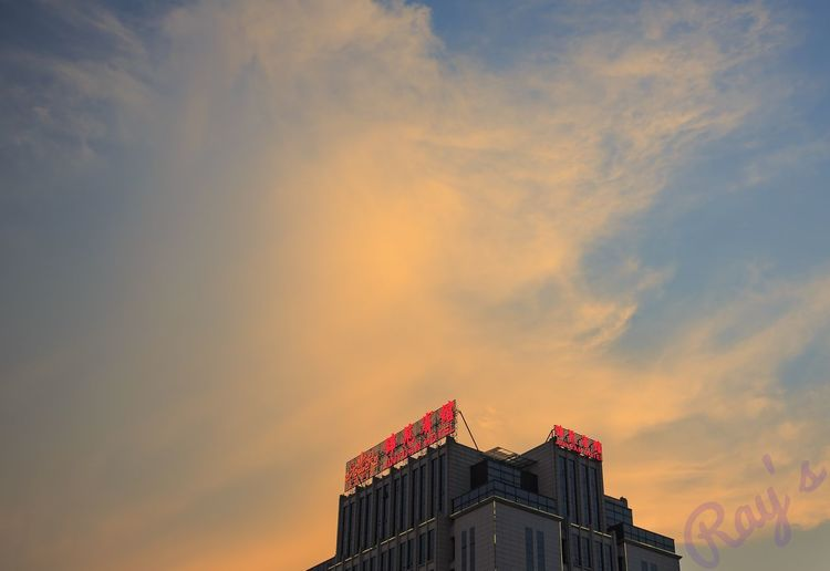 Low angle view of building against sky during sunset