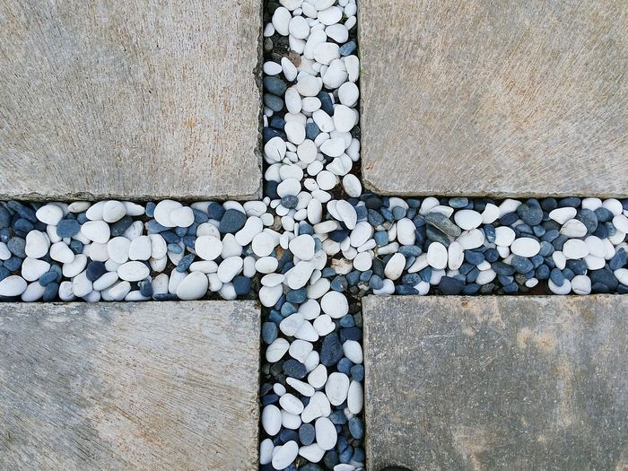 17.62° Learn & Shoot: Balancing Elements Stone - Object Stepping Stone The Next Step Stone Material Cobblestone Garden Path Stone Tile Ground Block Stone Carving - Craft Product Rough Marbled Effect Concrete Gravel Pebble Pebble Beach Stone Wall Cobbled Brick Wall