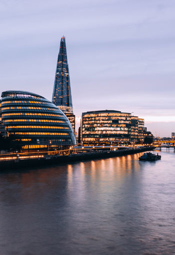 Architecture Building Building Exterior Built Structure City Cityscape Dusk Illuminated Nature No People Office Building Exterior Outdoors Reflection River Sky Skyscraper Transportation Travel Travel Destinations Water Waterfront