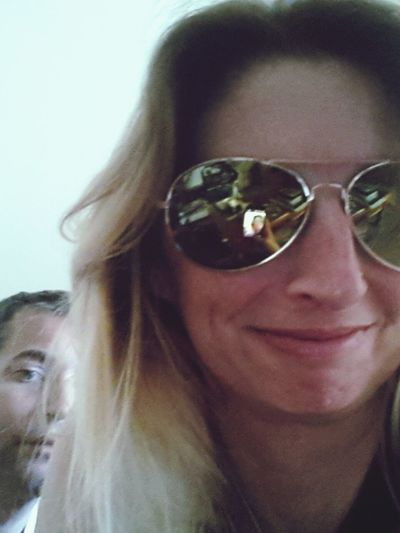 Close-up of young woman wearing sunglasses