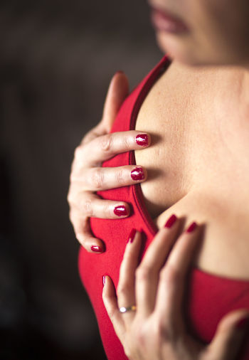 Close-Up Of Woman Touching Breast