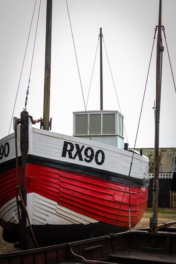 Moored Boat Text Sky Mode Of Transportation Transportation Western Script No People Communication Day Clear Sky Architecture Nautical Vessel Chain Number Low Angle View Built Structure Building Exterior Outdoors Nature Metal